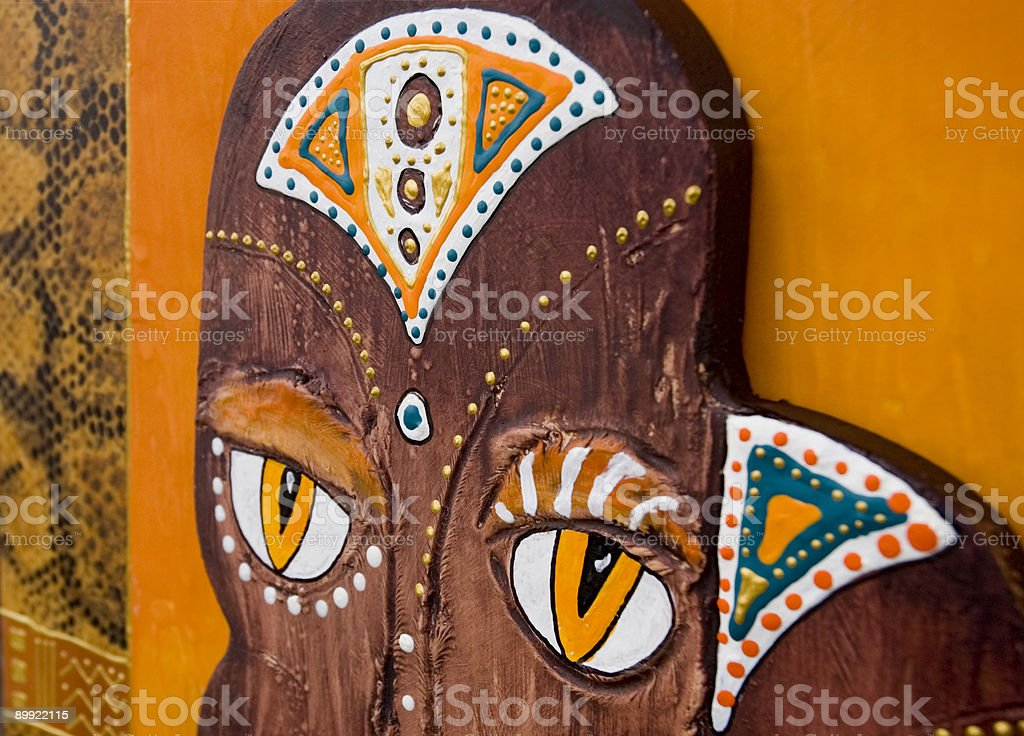 African Mask with yellow eyes royalty-free stock vector art