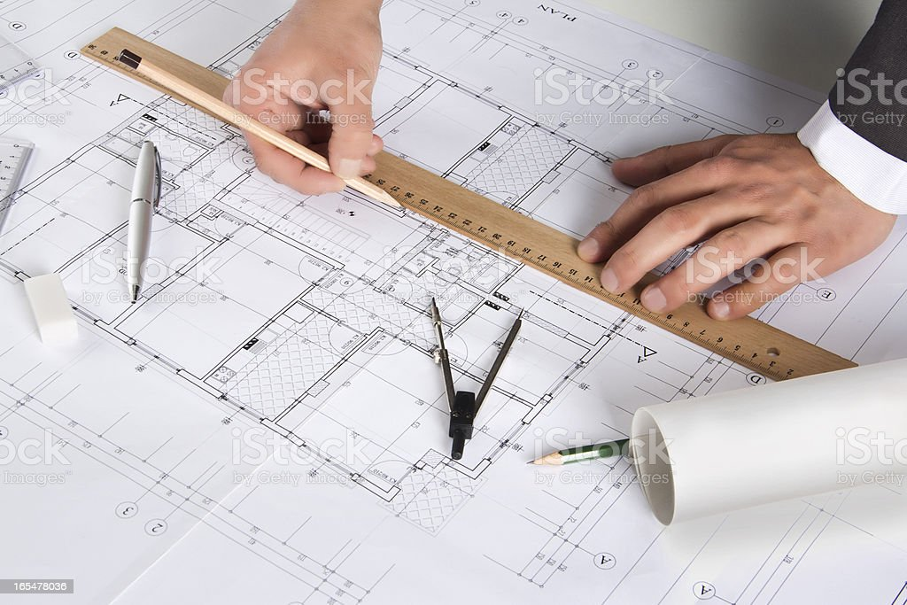 Architect working on architectural plans royalty-free stock vector art