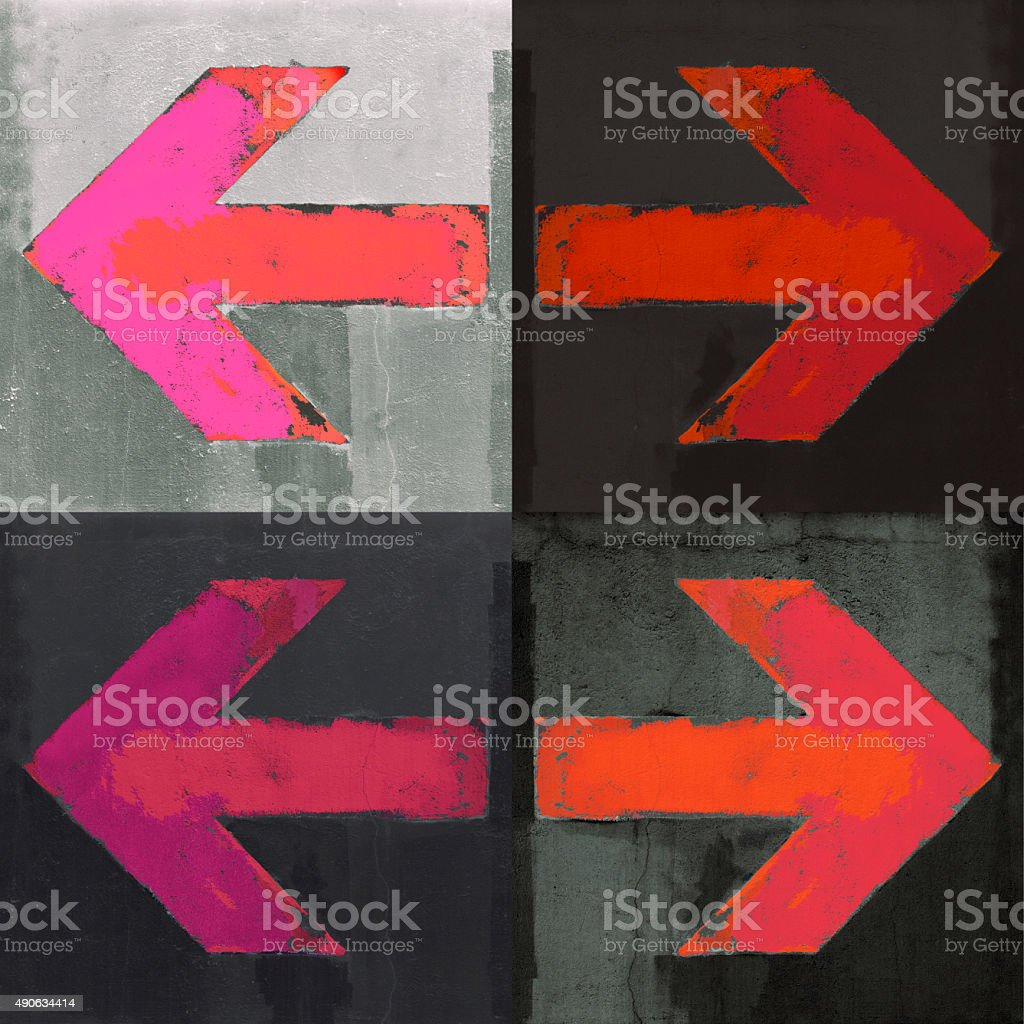 Artistic grunge design arrows set painted on a concrete wall stock photo