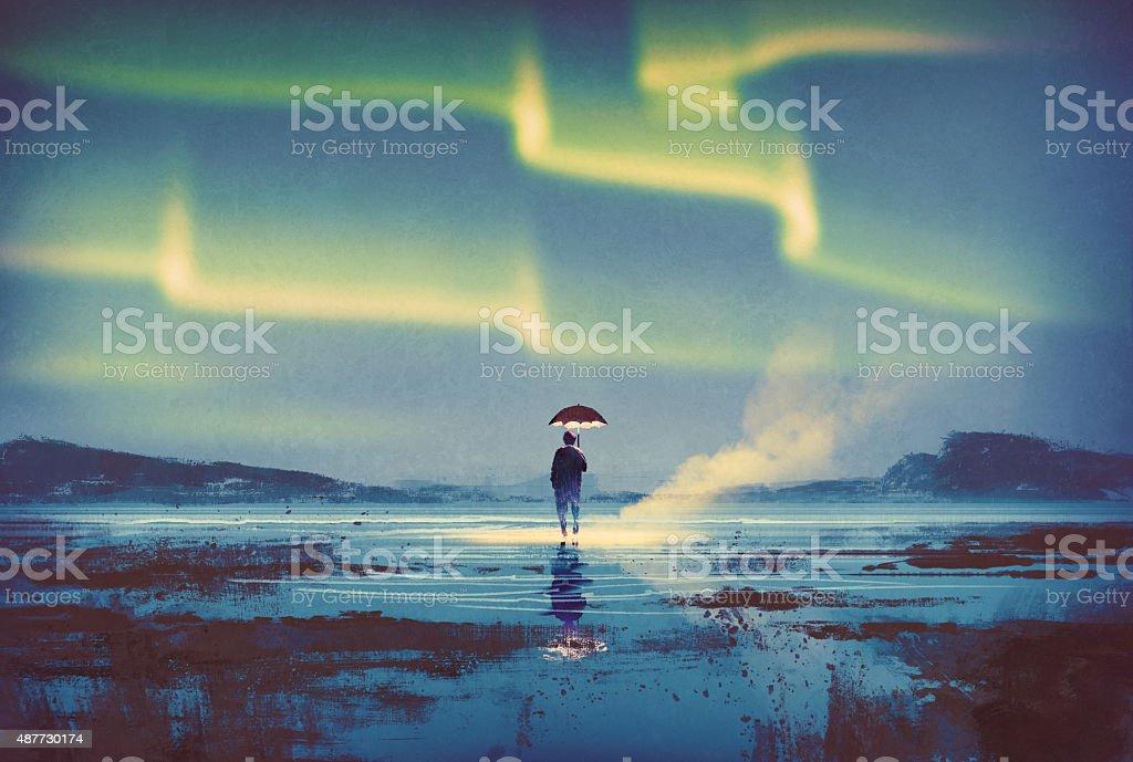 Aurora borealis over man holding umbrella lights vector art illustration