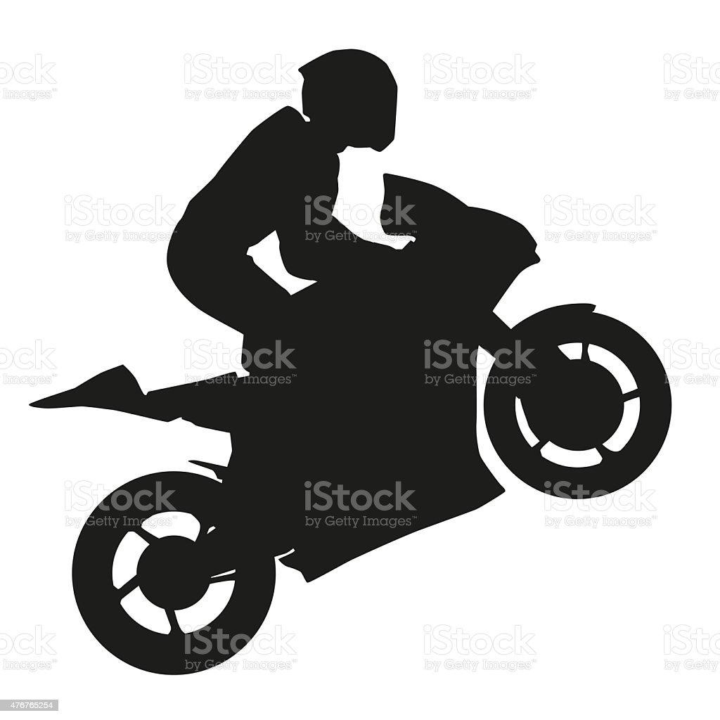 Biker rider lifts the front wheel vector art illustration