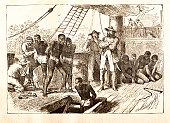 Black slaves loaded on ship 1881