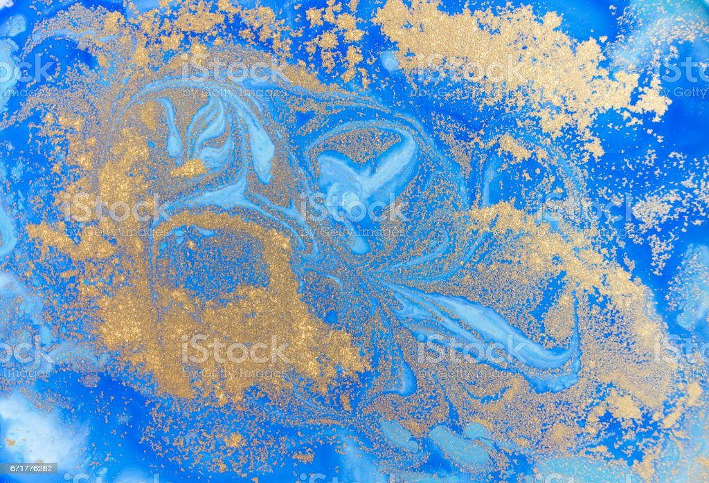 Blue and golden liquid texture. Watercolor hand drawn marbling illustration. Ink marble background. stock photo