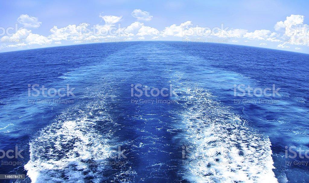 Blue Water Wake Pattern Behind Marine Vessel vector art illustration