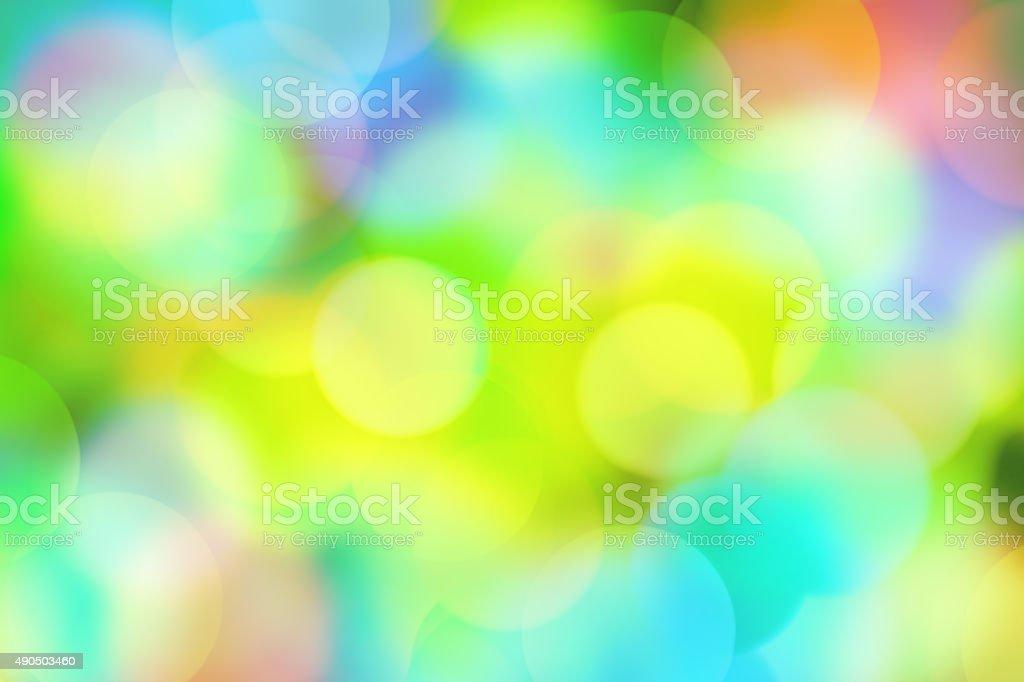 Blurred pastel multicolor bokeh dots vector art illustration