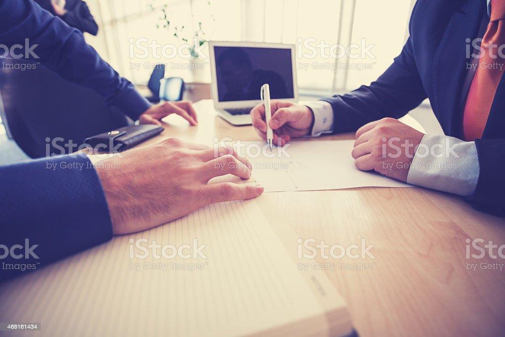 Business meeting - hands on office desk vector art illustration