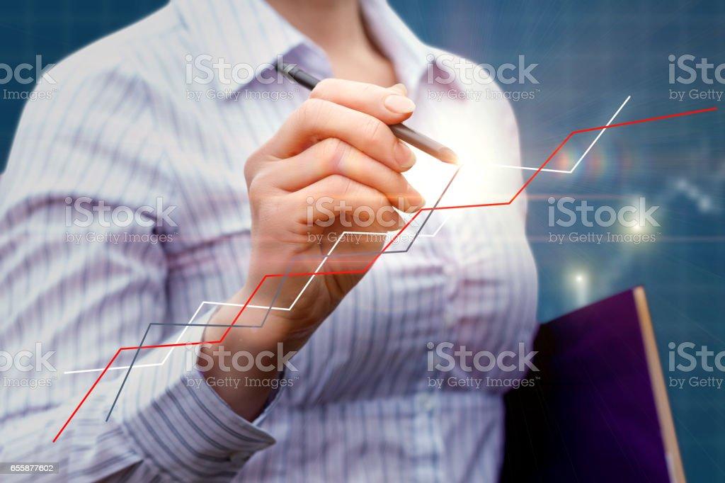 Businesswoman draws a graph . vector art illustration