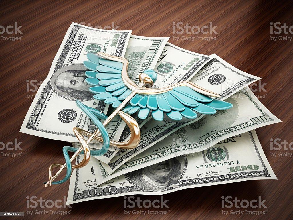 Caduceus on dollar pile standing on the table vector art illustration