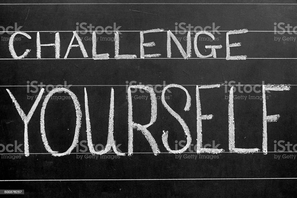 challenge yourself phrase handwritten on black chalkboard vector art illustration