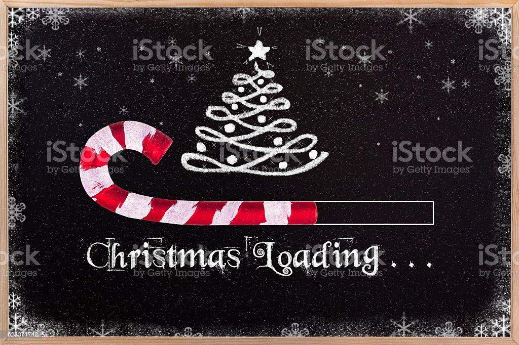 Christmas loading on blackboard. vector art illustration
