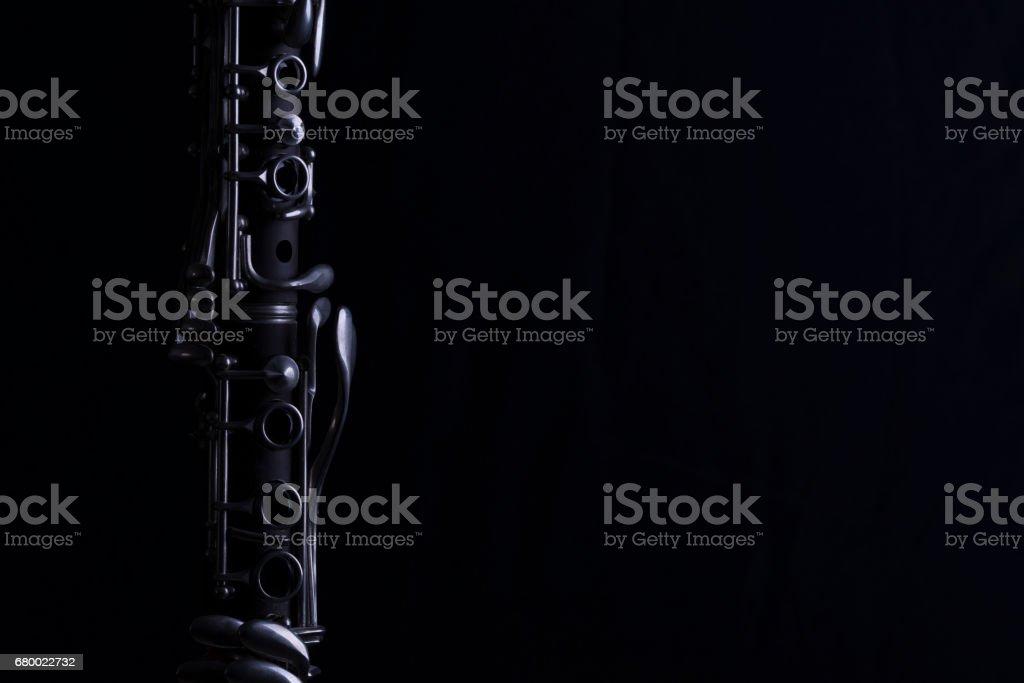 Clarinet on a black background. vector art illustration