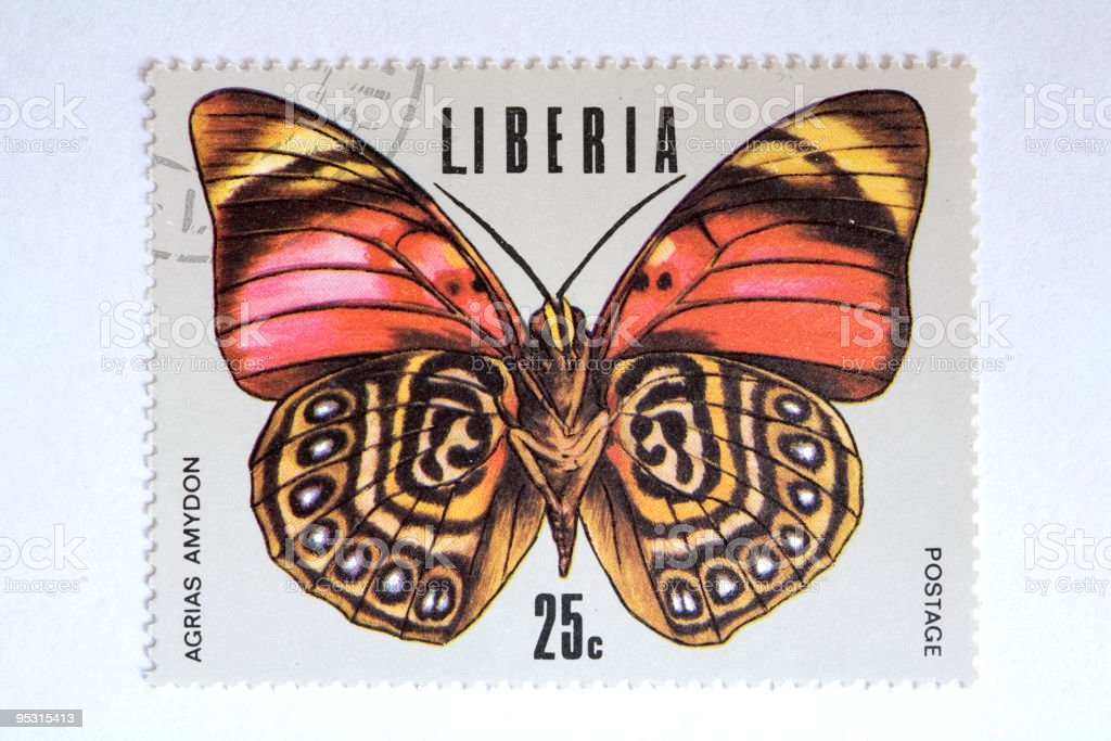 Close up of liberian post stamp showing a butterfly royalty-free stock vector art