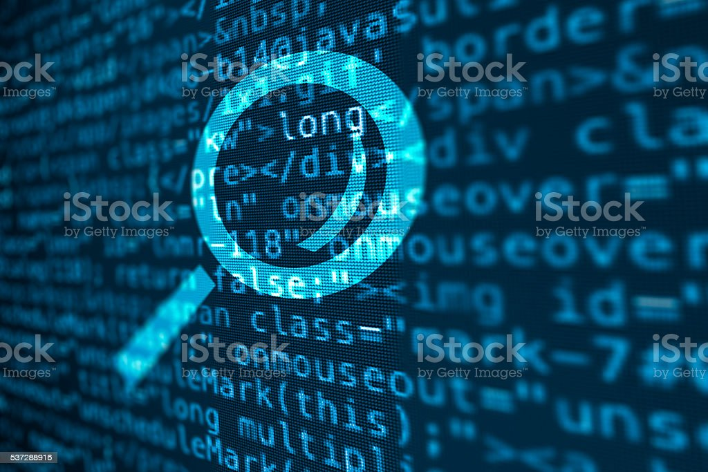 Computer data code screen with magnifying glass icon stock photo