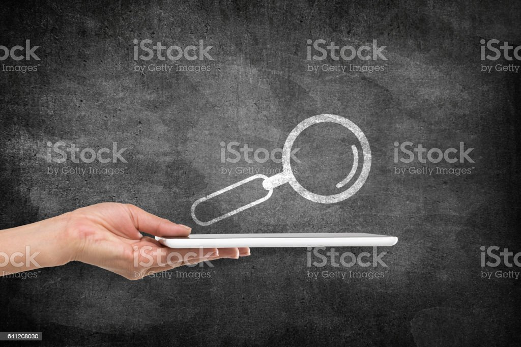 Digital tablet with magnifying glass icon on blackboard vector art illustration