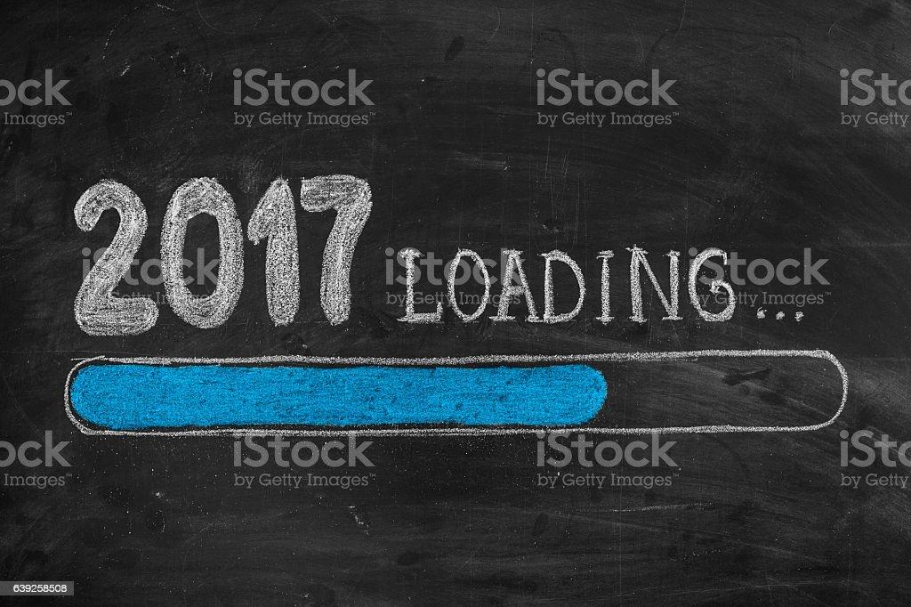 Drawing Loading New Year 2017 on Chalkboard vector art illustration