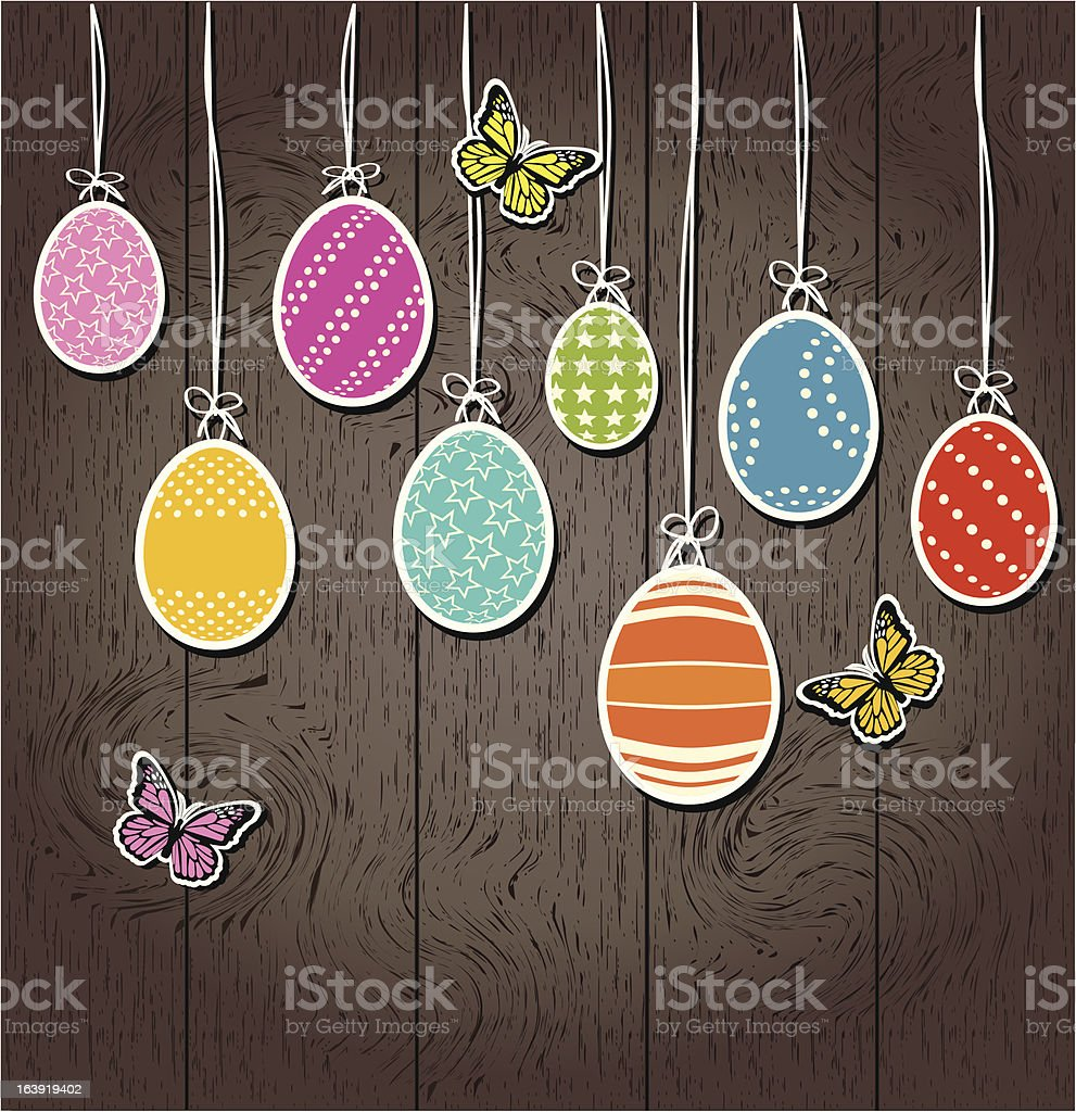 Easter eggs on a wooden wall background royalty-free stock vector art