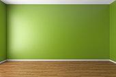 Empty green room with parquet floor