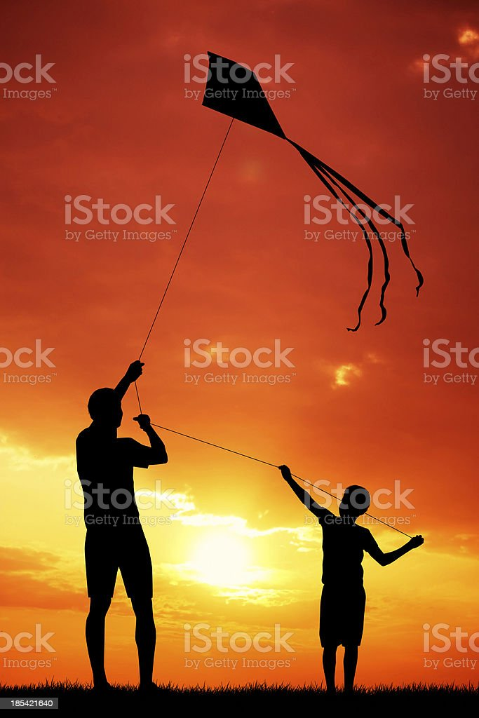father and son with kite vector art illustration