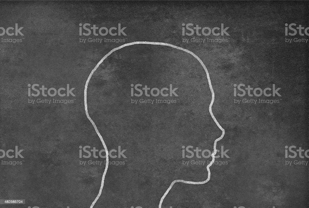 Female Head Shape on a Blackboard vector art illustration
