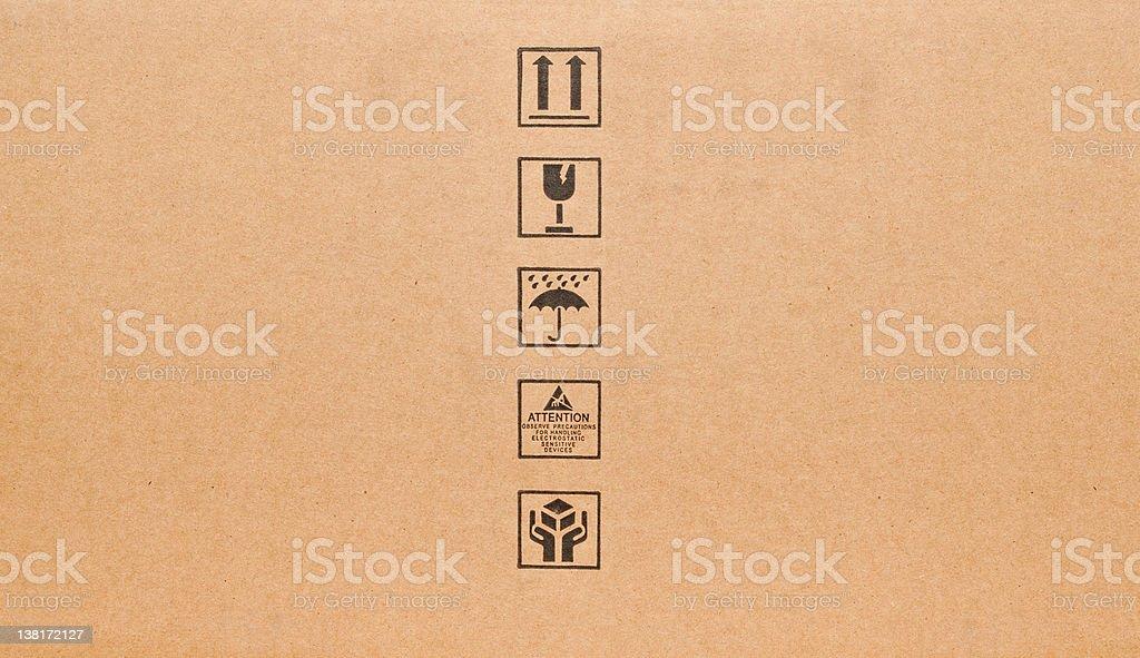 Fine image close-up of black fragile symbol on cardboard royalty-free stock vector art