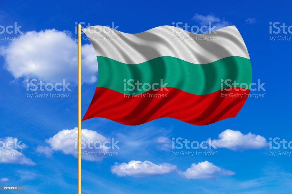 Flag of Bulgaria waving on blue sky background vector art illustration