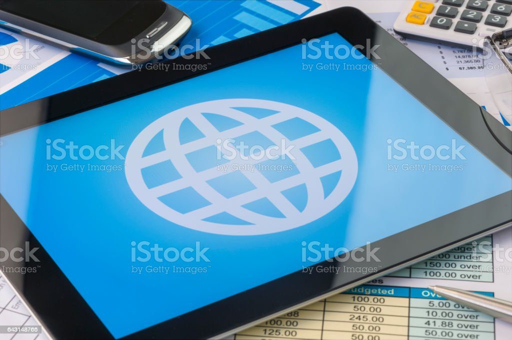 Globe icon on a digital tablet stock photo