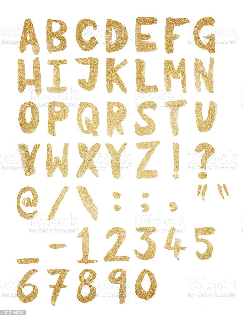 Gold foil hand drawn alphabet stock photo