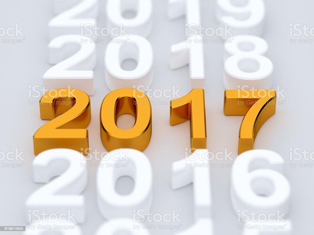 Golden 2017 year sign. Soft focus vector art illustration
