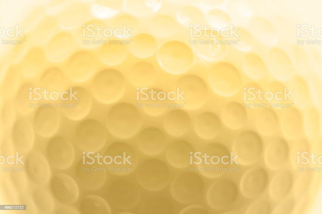 Golf ball texture, macro photography, soft golden color effect. vector art illustration