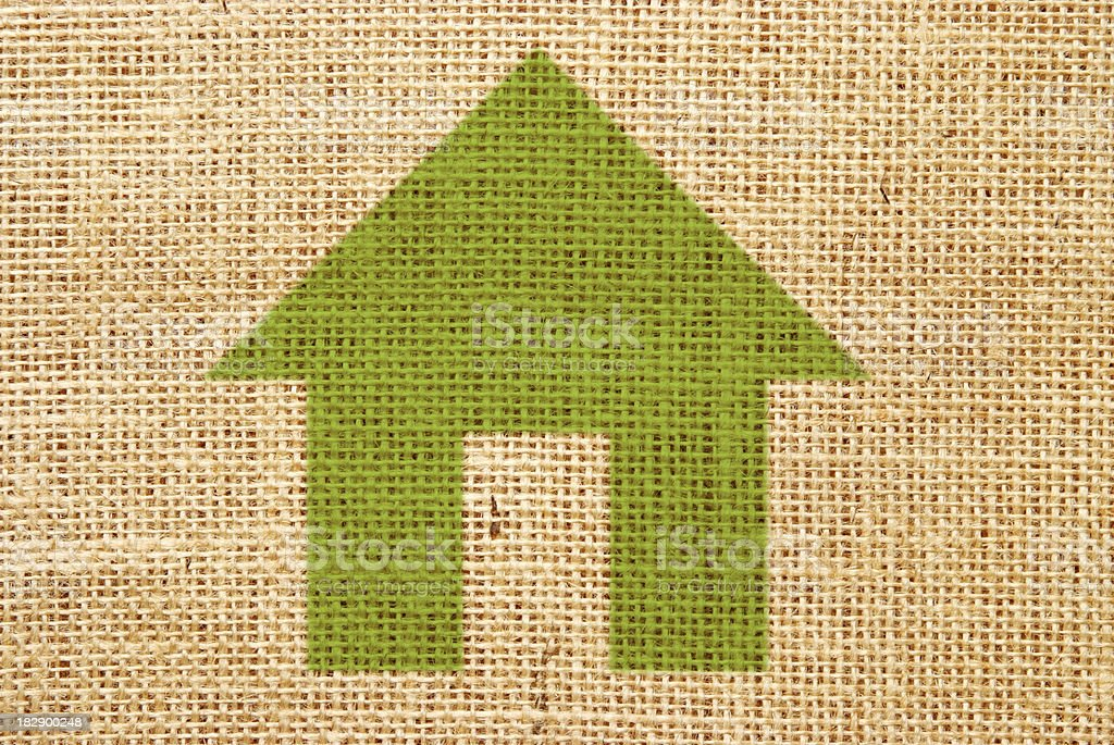 Green living symbol on hessian material royalty-free stock vector art