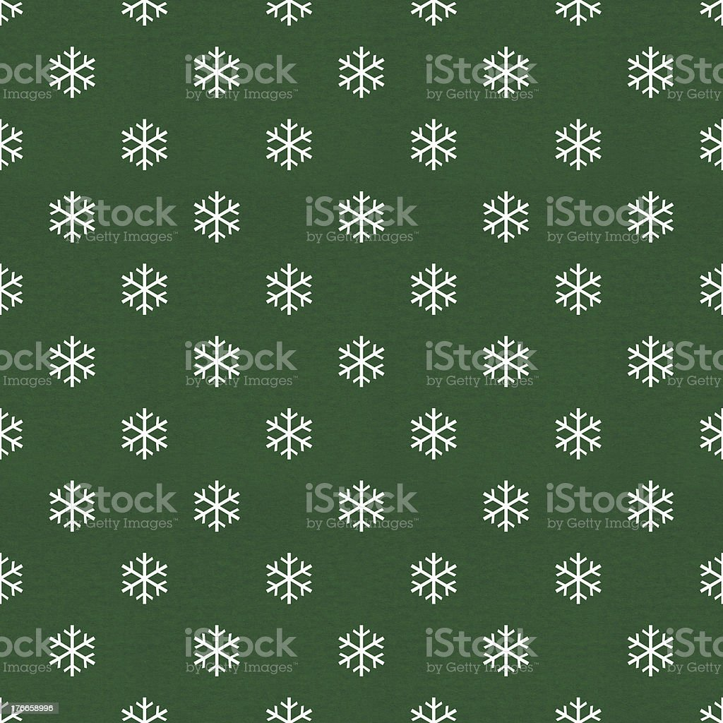 Green wrapping paper pattern with white snowflakes vector art illustration