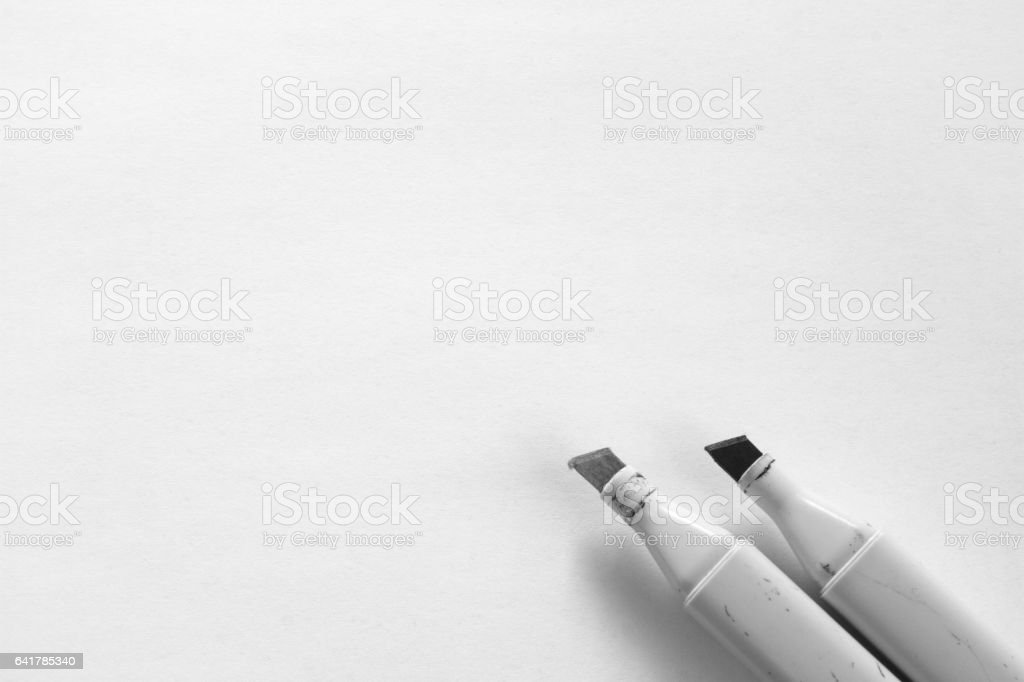 Grey markers on blank sheet of white paper vector art illustration