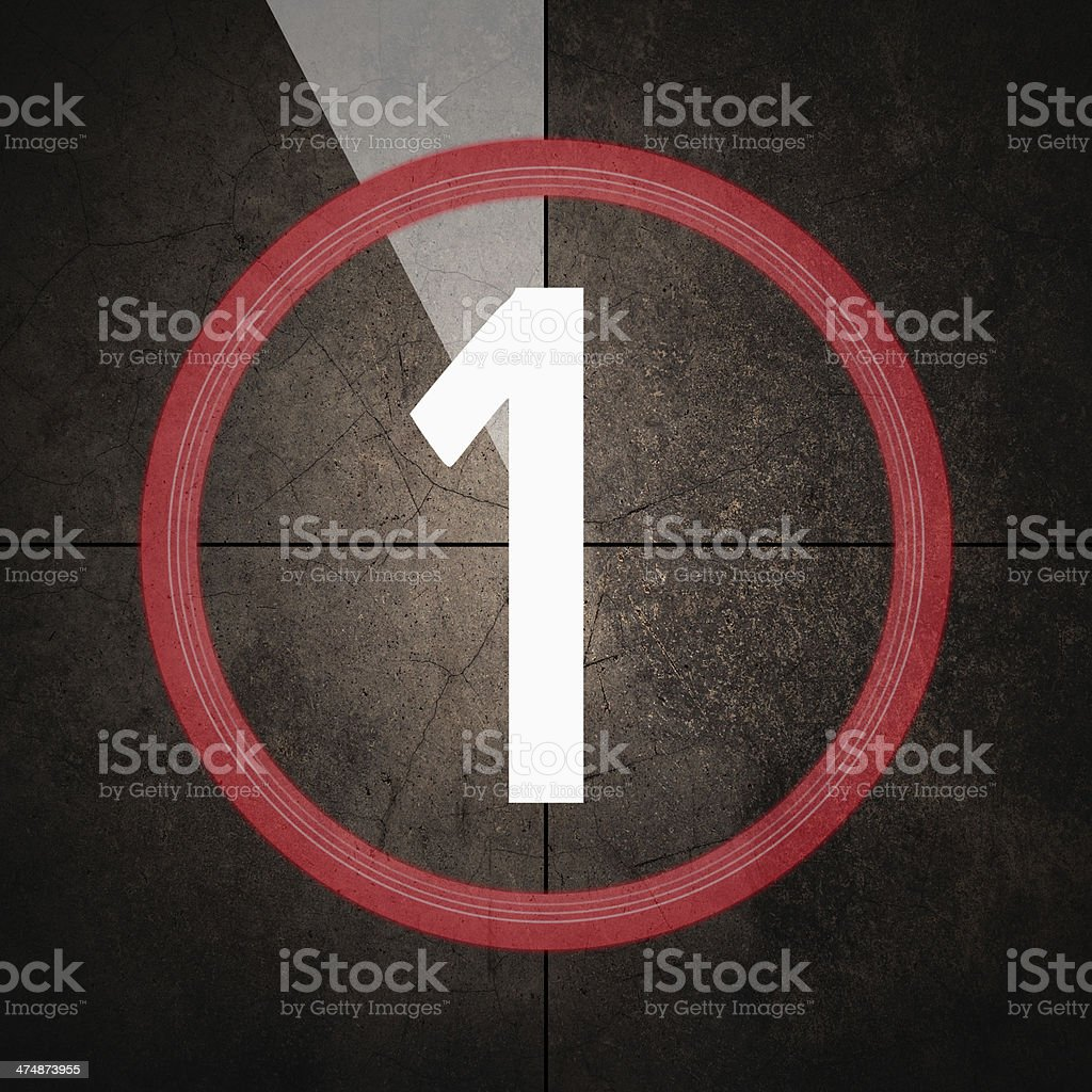 Last minute with number one on grunge background - warm royalty-free stock photo