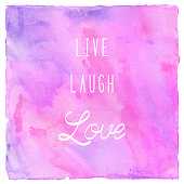 Live laugh love on colorful watercolor background
