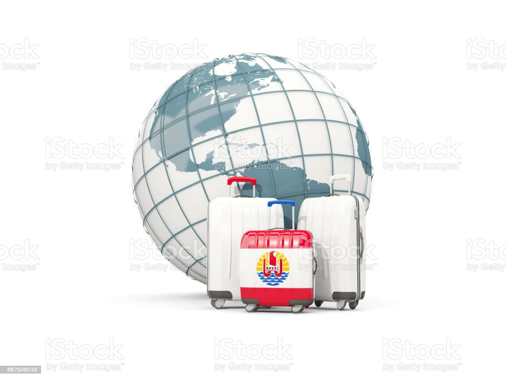 Luggage with flag of french polynesia. Three bags in front of globe stock photo