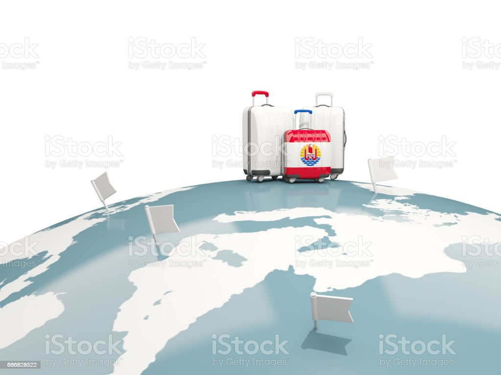Luggage with flag of french polynesia. Three bags on top of globe stock photo