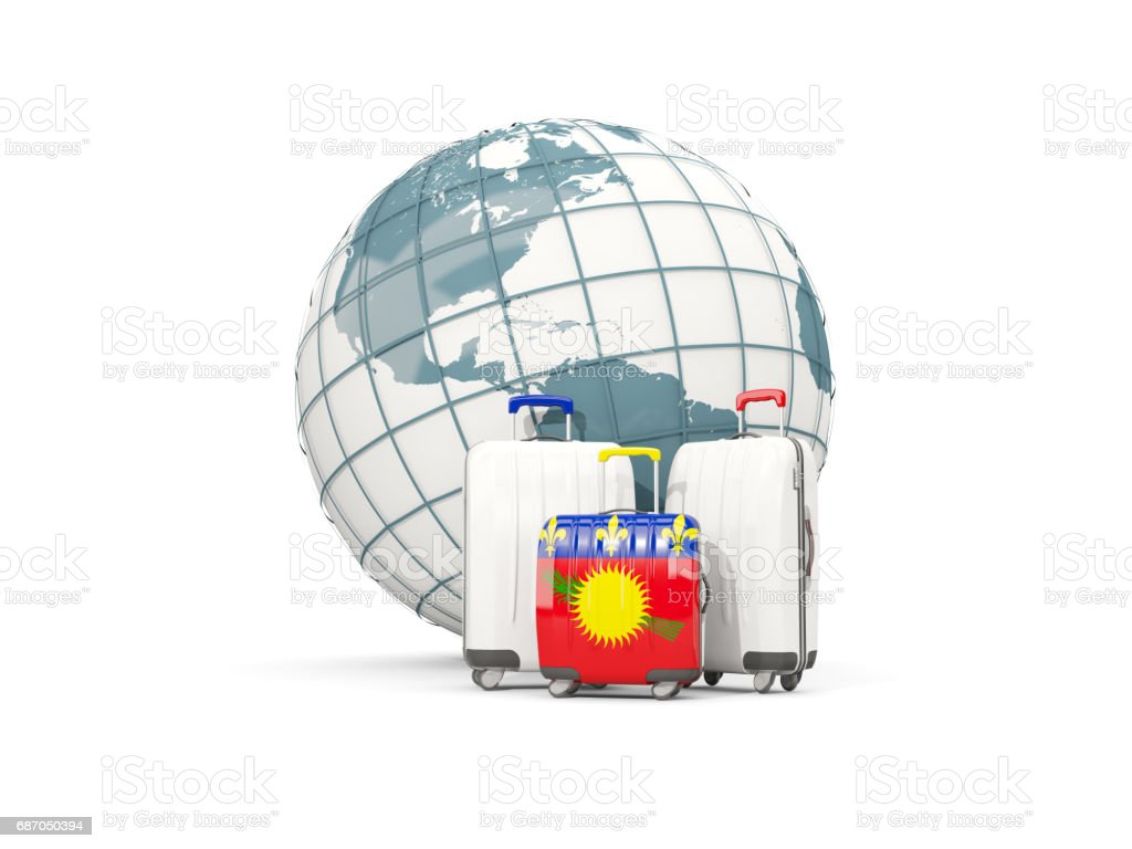 Luggage with flag of guadeloupe. Three bags in front of globe vector art illustration