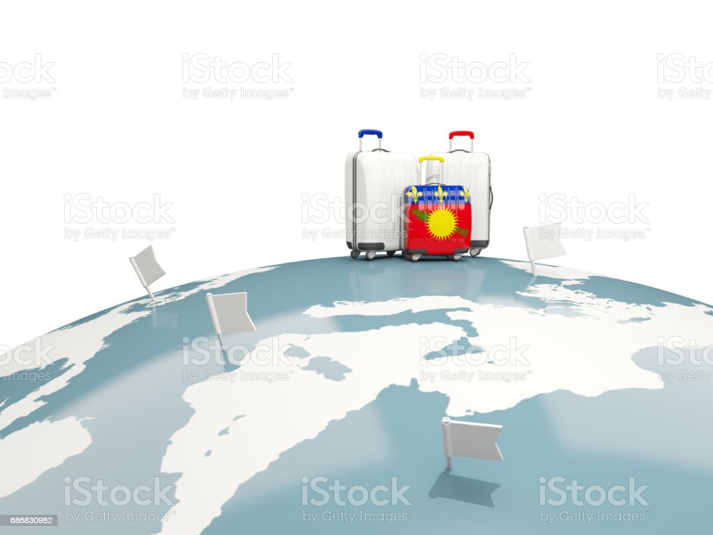 Luggage with flag of guadeloupe. Three bags on top of globe vector art illustration