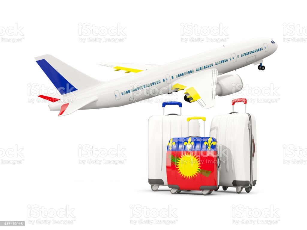 Luggage with flag of guadeloupe. Three bags with airplane vector art illustration