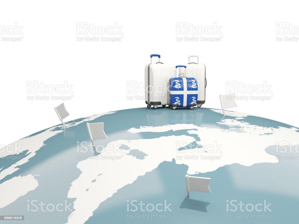 Luggage with flag of martinique. Three bags on top of globe vector art illustration