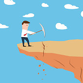 Man on a cliff edge digging ground