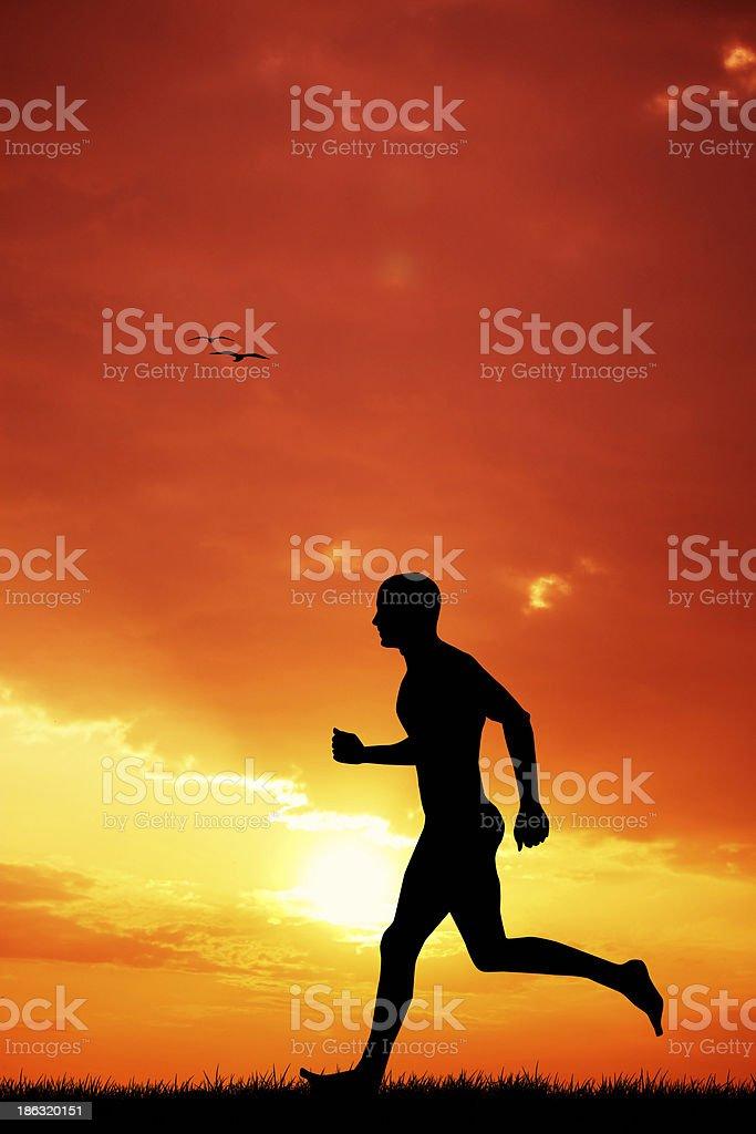 Man running at sunset royalty-free stock vector art