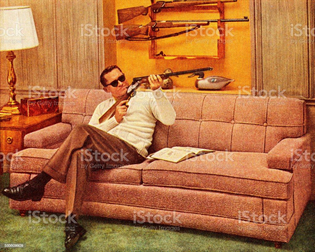 Man Wearing Sunglasses and Holding Gun vector art illustration