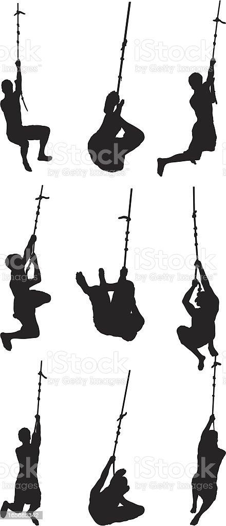 Men swinging on rope royalty-free stock vector art