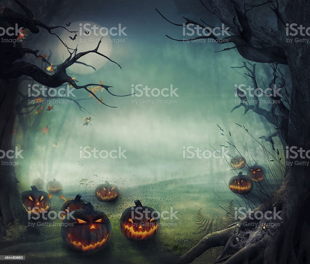 Menacing forest pumpkins, glowing on a foggy moonlit night royalty-free stock vector art
