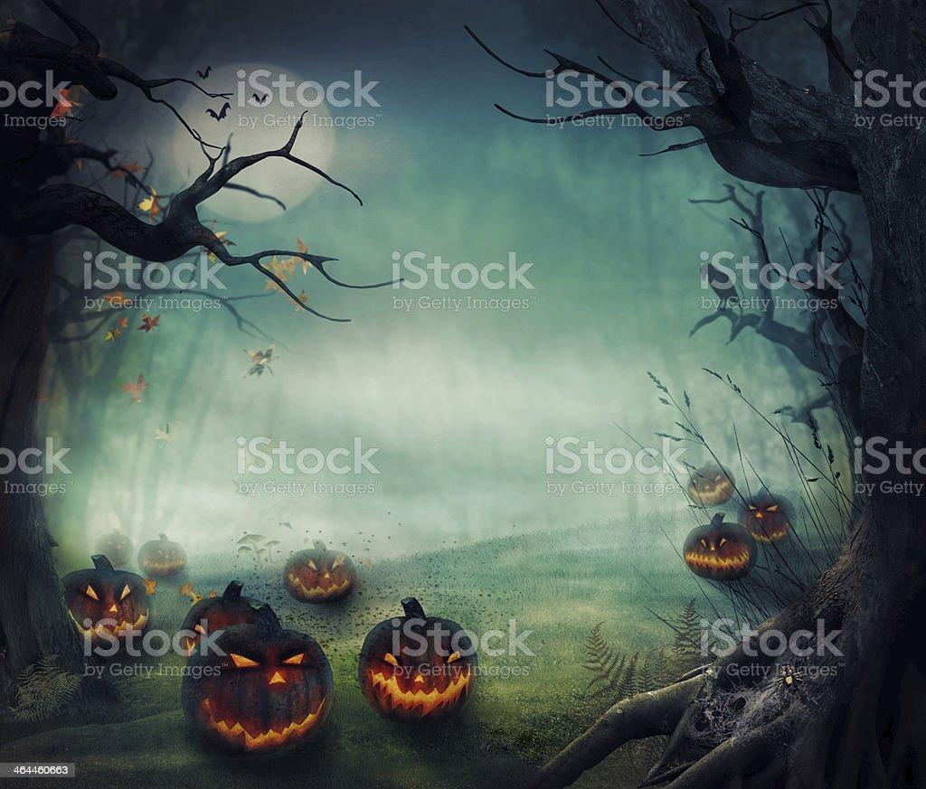 Menacing forest pumpkins, glowing on a foggy moonlit night vector art illustration