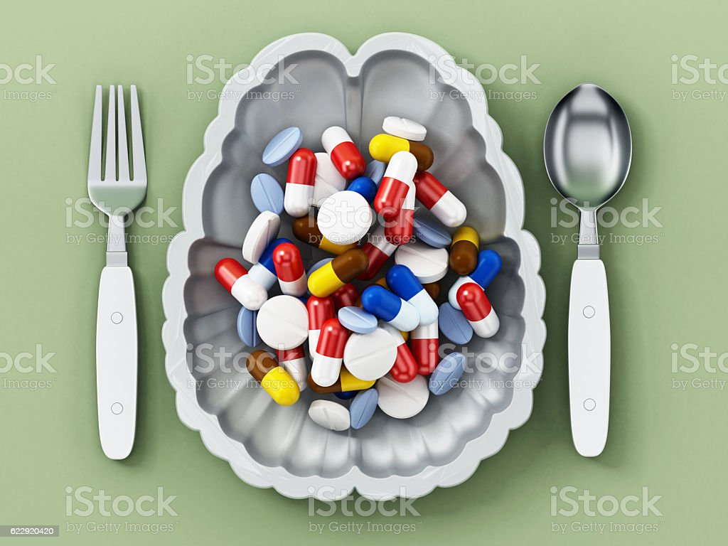 Multi-colored pills inside brain shaped serving plate vector art illustration