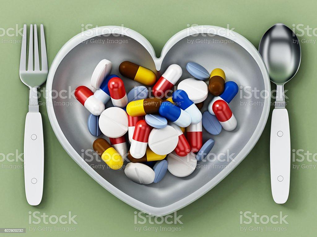 Multi-colored pills inside heart shaped serving plate vector art illustration