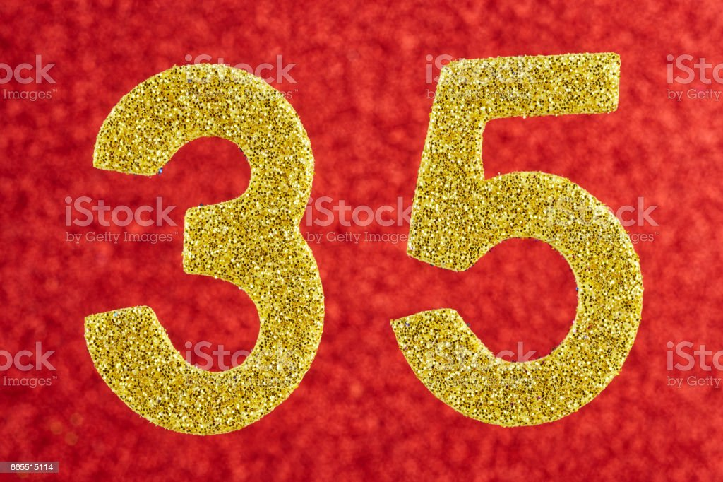 Number thirty-five yellow color over a red background. Anniversary. stock photo