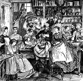 Numerous Victorian people in a kitchen